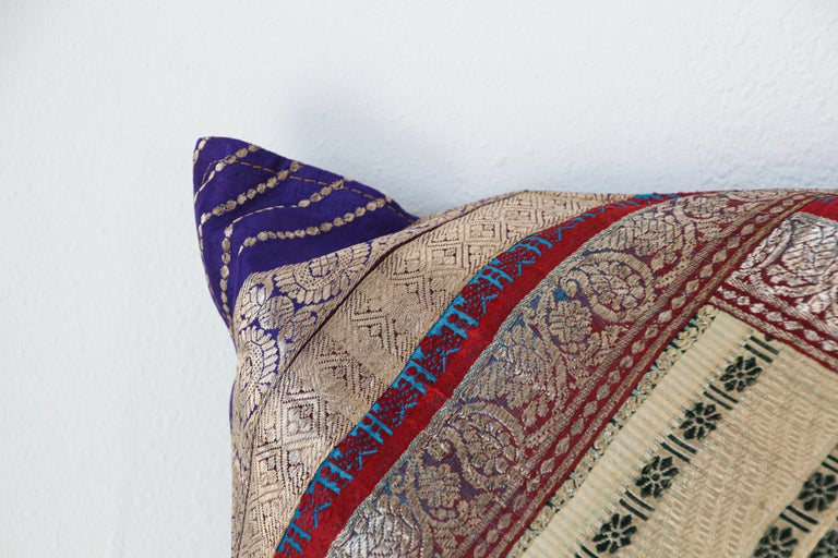 Decorative accent throw pillow made from vintage sari borders. One of a kind, blue, green, gold, green, purple, metallic threads. Handcrafted in India. We do have multiple in this style, but each one is unique.