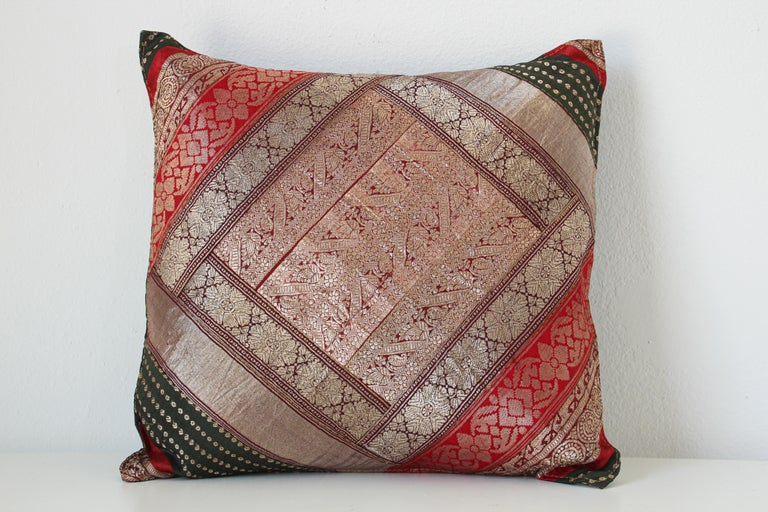Decorative accent silk throw pillow made from vintage sari borders. One of a kind silk sari, red, green, gold, green, purple, metallic threads sari borders. Handcrafted in India. We do have multiple in this style, but each one is unique.