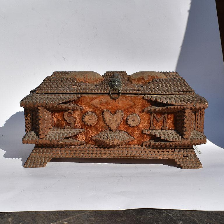 Primitive Folk Art sailors valentine Tramp Art keepsake box. Wide in form, this beautiful Primitive wood carved box features the letters S and M with a heart between on both sides. Two yellow velvet tufts decorate the top and sides, and the entire