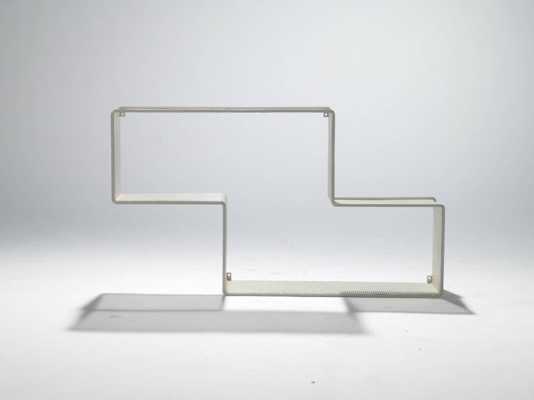 With its strong lines, minimal materials, and amusing design, this wall shelf is iconic of the Hungarian and French designer Mathieu Matégot. The designer strived to create objects of beauty and imagination that were also functional. This particular
