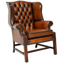 Deep Buttoned Leather Wing Back Armchair
