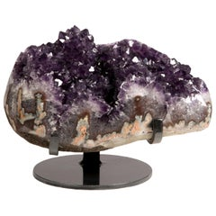Deep Purple Stalactite Formations on Metal Stand