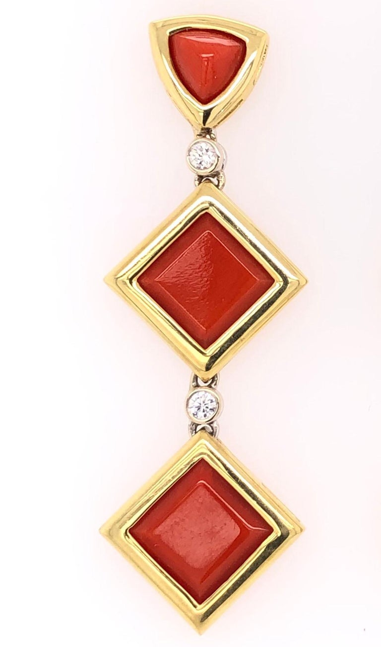 Simply Beautiful, Stylish and finely detailed Deep Red Coral and Diamond Drop Gold Earrings. Hand crafted in 18 Karat Yellow Gold and hand set with square Coral gemstones, approx. 45.00 total Carat weight and Diamonds, weighing approx. 0.24 total