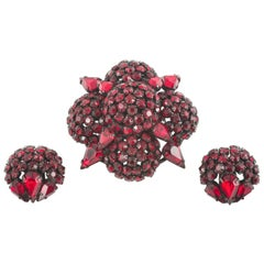 Deep ruby paste 'cruxiform'  brooch and earrings, Warner, 1950s