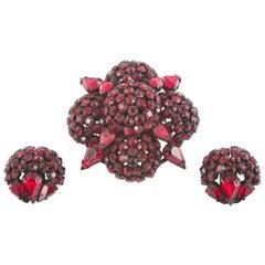 Deep ruby paste 'cruxiform'  brooch and earrings, Warner, USA, 1950s