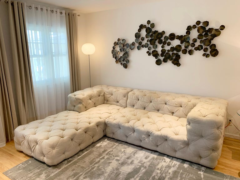 Beautiful deep tufted sectional sofa upholstered in cream colored linen fabric, excellent condition, beautifully made and ready to complete your project.