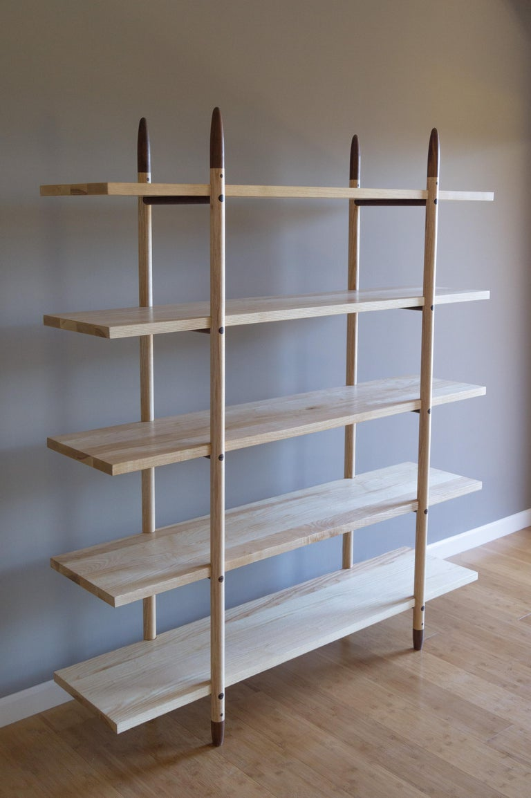 The Deepstep shelving includes exquisite wood detailing and a clean, clear profile. Designed entirely without fasteners or screws, using a mix of traditional and innovative wood joinery instead.   Handmade with the highest level of craftsmanship