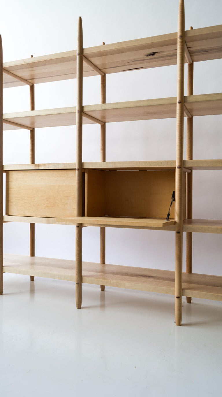 The Deepstep shelving includes exquisite wood detailing and a clean, clear profile. Designed entirely without fasteners or screws, the design instead utilizes traditional and innovative wood joinery solutions. 