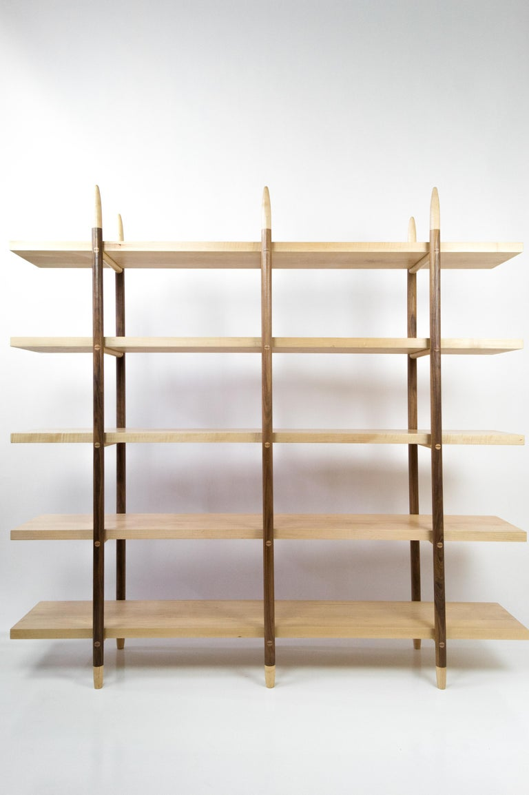 The Deepstep shelving includes exquisite wood detailing and a clean, clear profile. Designed entirely without fasteners or screws, the design instead utilizes traditional and innovative wood joinery solutions.   Designed and handmade with the