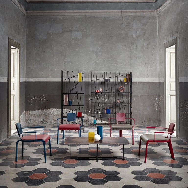 Striking and contemporary, this bookcase is composed of various metal sheets of different textures juxtaposed and welded in an eclectic geometric composition. Featuring a rectangular silhouette and five shelves, this piece is also available with a