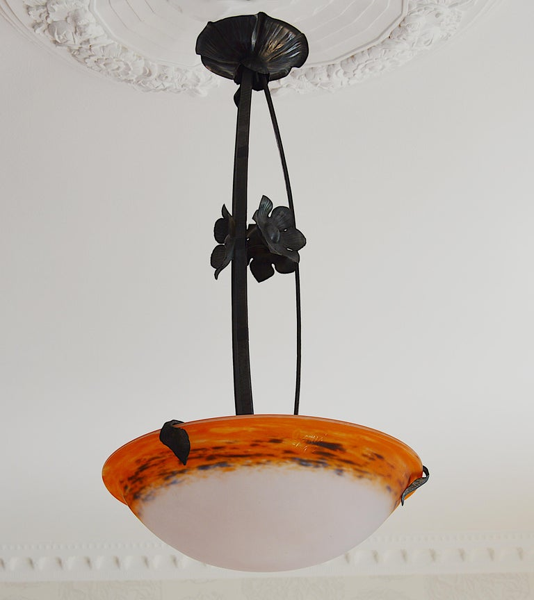 Summer sales. We are renewing our stock waiting for the start of September. Do not wait to order this beautiful period piece, we only have one. French Art Deco pendant by Degue, Compiegne, France, late 1920s. Mottled glass shade, powders are applied