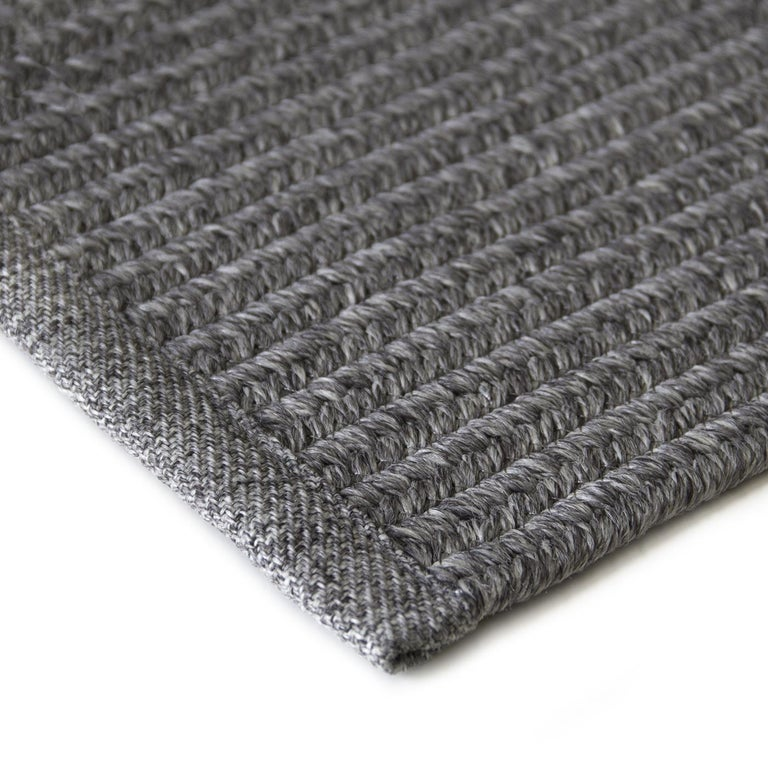 This elegant, reversible rug boasts a delicate braided texture that will imbue a room with subtle sophistication. It is machine fashioned of polypropylene, which makes it resistant to humidity and sunlight, and impervious to mites. This piece is