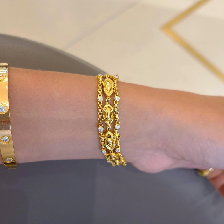 Women's or Men's DeLaneau 18 Karat Yellow Gold and Diamond Watch with Diamond Bows For Sale