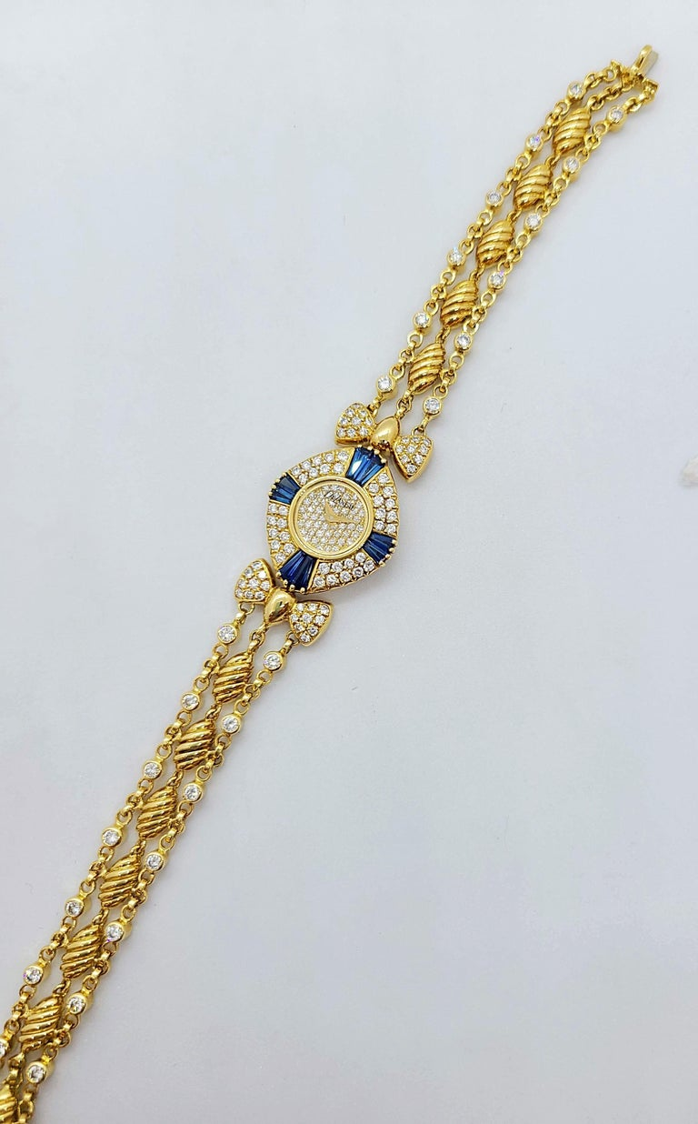 DeLaneau was founded by a woman in 1949 in Switzerland.  They are one of the first watch companies to devote their entire collection to ladies timepieces. The face of this 18 karat yellow gold cushion shaped watch is set with pave diamonds. The