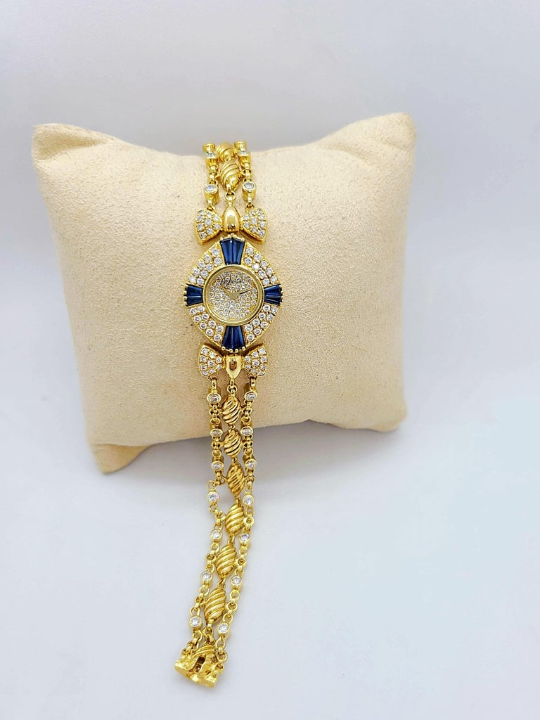 Round Cut DeLaneau 18 Karat Yellow Gold Diamond and Blue Sapphire Bracelet Watch For Sale