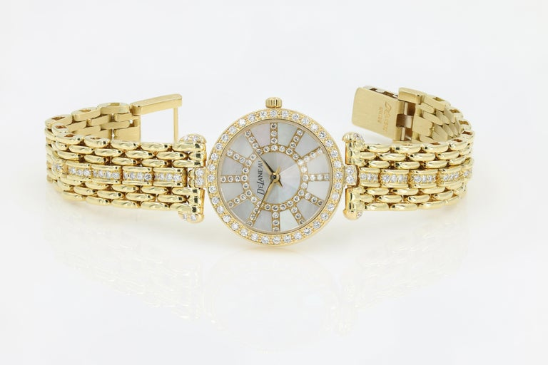 DeLaneau 18kt Yellow Gold & Diamond Bracelet Watch w/Faceted Crystal & MOP Dial - (Pre-owned - recently serviced and in excellent condition) - Lady's DeLaneau l8kt. yellow gold Swiss quartz watch.  Mother of Pearl dial with diamond. Diamond bezel