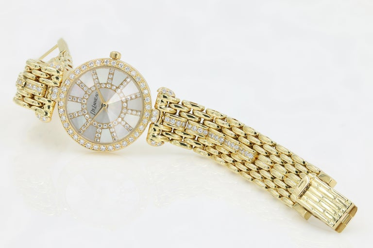 DeLaneau 18kt Yellow Gold & Diamond Bracelet Watch w/Faceted Crystal & MOP Dial In Excellent Condition For Sale In Chicago, IL