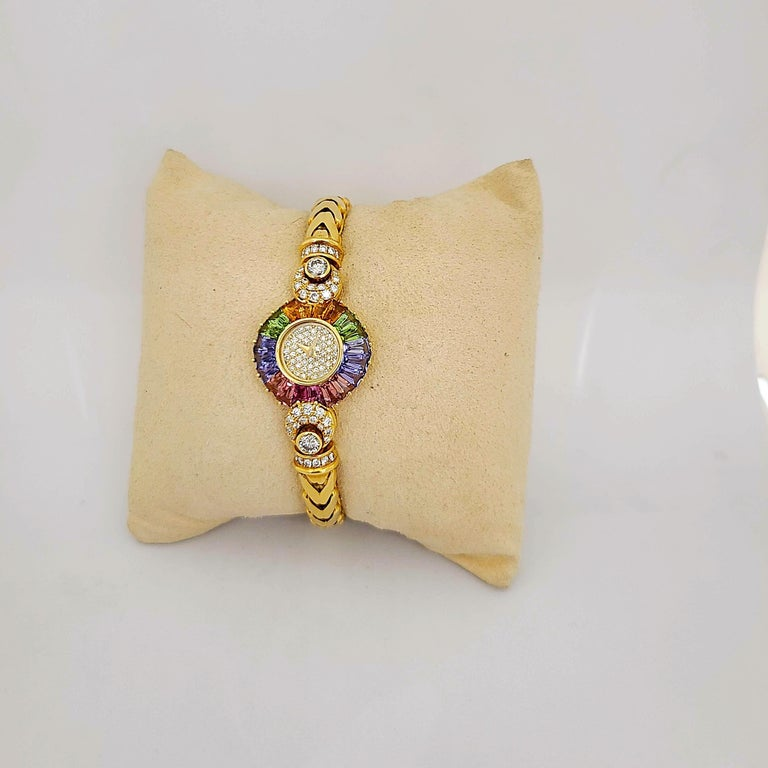 Baguette Cut DeLaneau 18 Karat Yellow Gold Diamond and Multicolored Sapphires Bracelet Watch For Sale