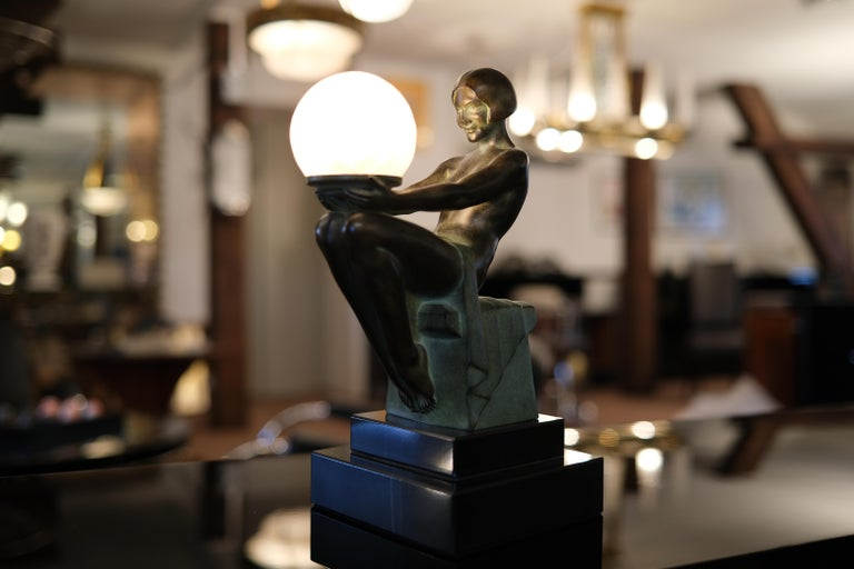 Patinated Delassement Lumineux French Art Deco Sculpture Lamp by Max Le Verrier For Sale