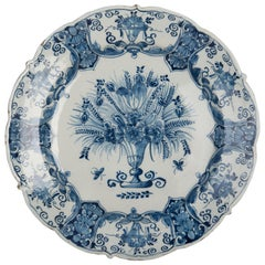 Delft, Large Blue and White Dish with Flower Vase, 1750, the Three Bells Pottery