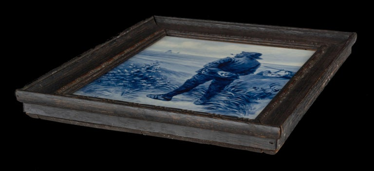 A Porceleyne Fles Delft hand-painted plaque (Large tile) after a painting by E. Verveer. The plaque is executed in Delft blue color. The plaque is painted by H.C. Bottelier who worked for the Porceleyne fles factory from 1880 to 1924. The year
