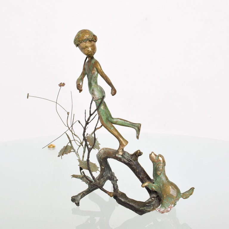 In the style of  Giacometti a figural sculpture in vintage patinated bronze boy on a tree branch with his dog looking upwards. Lovely light and delicate sculpture in a beautiful verdigris patinated bronze. Measures: 7