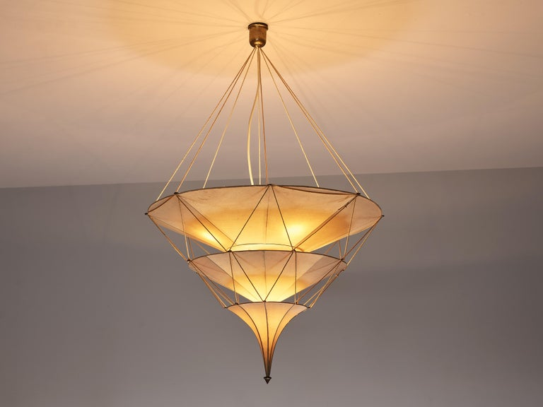 Mariano Fortuny, chandelier 'Icaro', silk, fibre, metal, brass, cord, Italy, designed 1920s  This elegant 'Icaro' chandelier by Mariano Fortuny was designed around 1920. It has a theatrical expression and atmospheric light. Three layers of shades