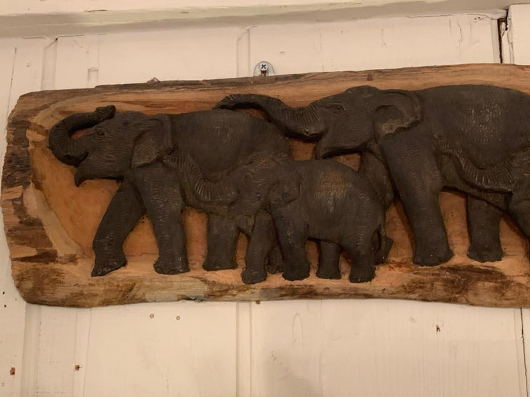 Handsome carved wood wall relief sculpture of a family of 5 elephants in a horizontal line.