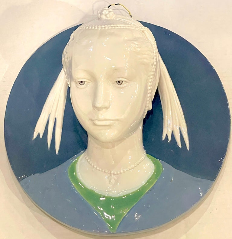 Della Robbia style sculpted portrait plaque of Jeweled Maiden, by Cantagalli An impressive late 19th century example, subtly detailed, three dimensional circular portrait.