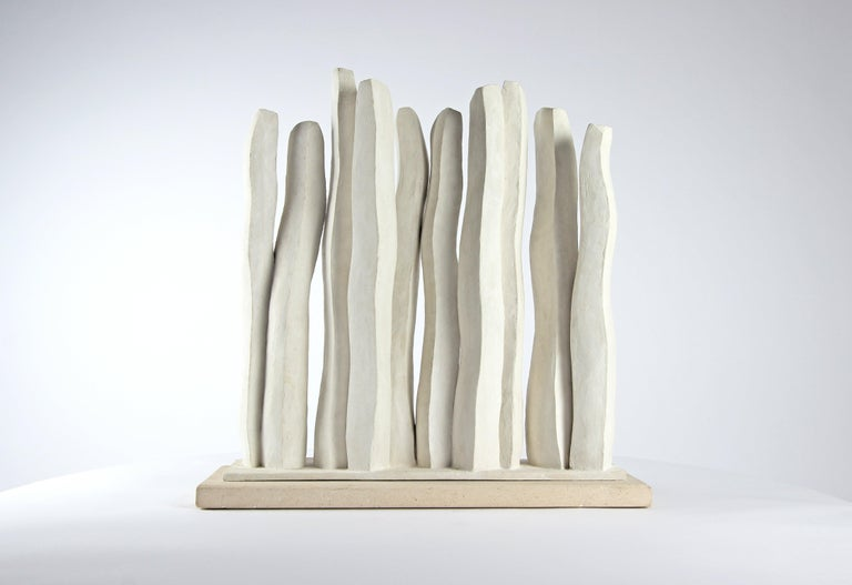 """Silhouettes (2014-2015) is a one-off plaster sculpture by French contemporary artist Delphine Brabant from the """"Raising"""" series. Dimensions : 50 cm × 51 cm × 15 cm. The artist favors expressionist and minimalist shapes. Her study revolves around the"""