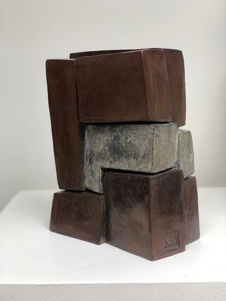Unity II, is a bronze sculpture by French contemporary artist Delphine Brabant. 25 cm × 12 cm × 12 cm. Limited edition of 8 + 4 A.P.  Fascinated with the concept of construction, Delphine Brabant composes her abstract sculptures like an architect,