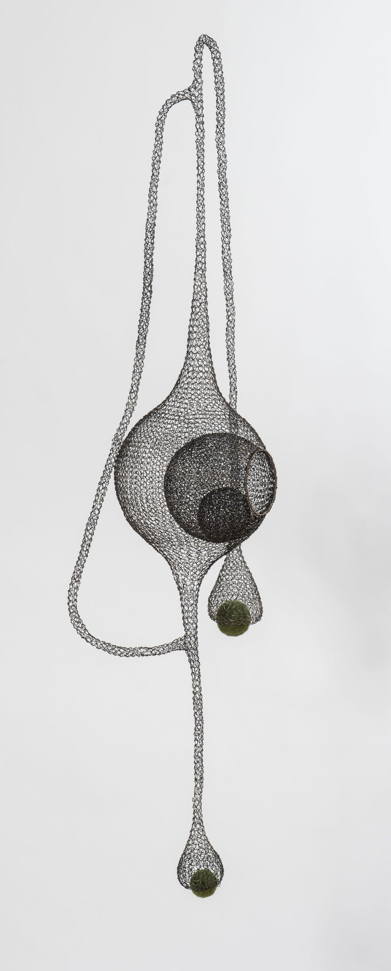 An airy meshwork of aesthetic shapes combining with felted green wool, this sensual sculpture named « Safe harbor III» is created and entirely handmade from black annealed iron wire and felting wool by artist Delphine Grandvaux. The artist says: