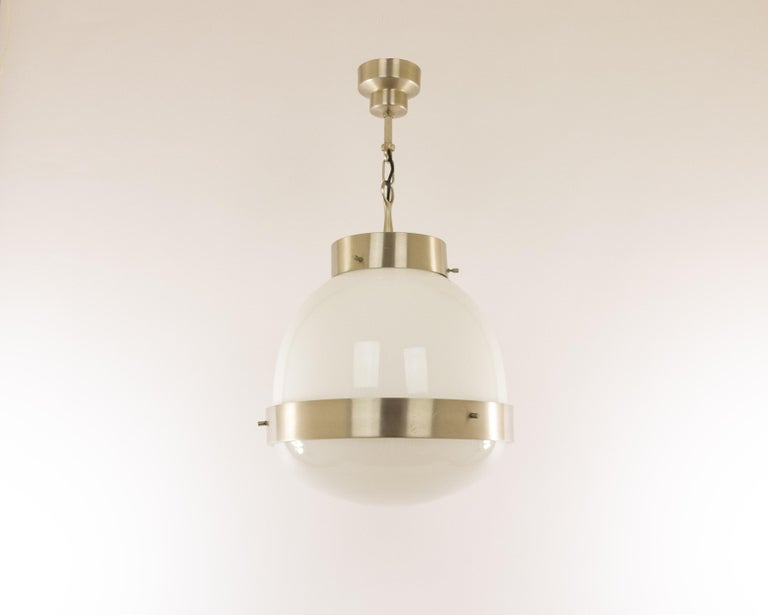 Sergio Mazza designed this Delta Grande pendant for Italian lighting manufacturer Artemide in the 1960s.  The model consists of a pressed crystal bowl and an opaline shade. The structure is from matt nickel-plated brass.  The condition of the