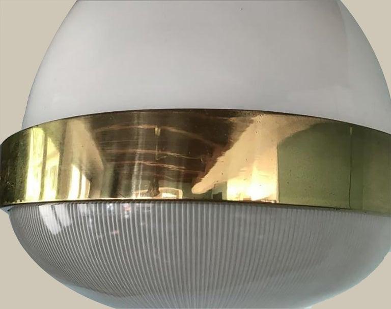 Pair of delta pendant light large model designed by Sergio Mazza for Artemide in the 1960s. Illuminates beautifully.  Dimensions: Height (84 cm), diameter 10.2