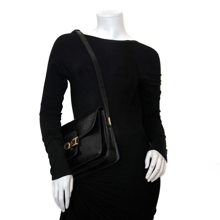 Good Vintage condition  Delvaux Black Croco Bourgogne Shoulder Bag  A showstopping piece from the premium Belgium luxury leather goods brand Delvaux, which excels in both style and quality.  This very hard to find black crocodile Bourgogne bag with