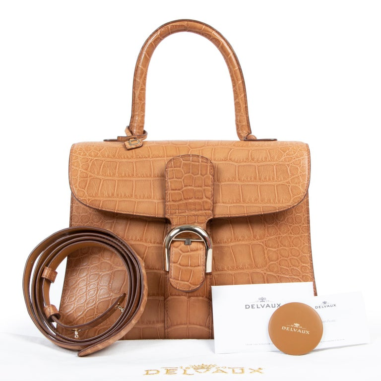 BRAND NEW  Delvaux Brillant MM Biface Alligator Dolce Végétal  A prestigious token of elegance and pure luxury: this Delvaux Brillant MM Biface Alligator Dolce Végétal is one-of-a-kind. The front is crafted out of sublime alligator skin in a warm
