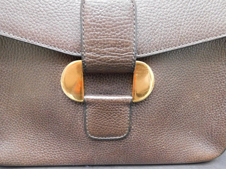 A very versatile Delvaux crossbody handbag in brown calfskin leather with gold hardware, and soft lambskin suede interior. The handbag is in good pre-loved condition(as shown in the photos ) . This Delvaux will quickly become your favorite