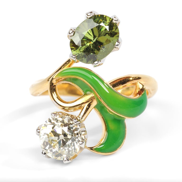 This contemporary 14K yellow gold ring was created in the style of the Russian Art Nouveau era and features a huge and impressive demantoid garnet measuring approximately 8.38mm x 6.69mm and weighing just over 2 carats. This rare and flashy gem is