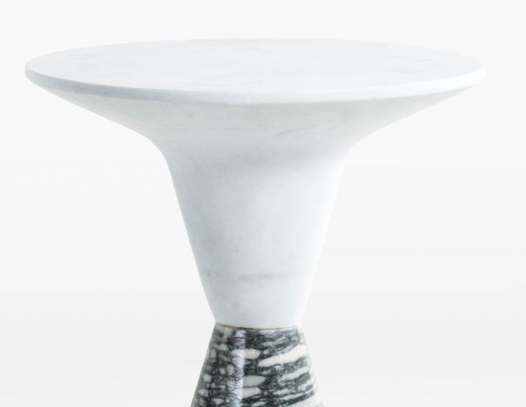 Two cone-shaped cylinders of solid marble join to form the DeMarco side table. Shown with white marble top and Verdi Nuvoloso base. Designed and built by KGBL. Made to order. Please specify quantity.