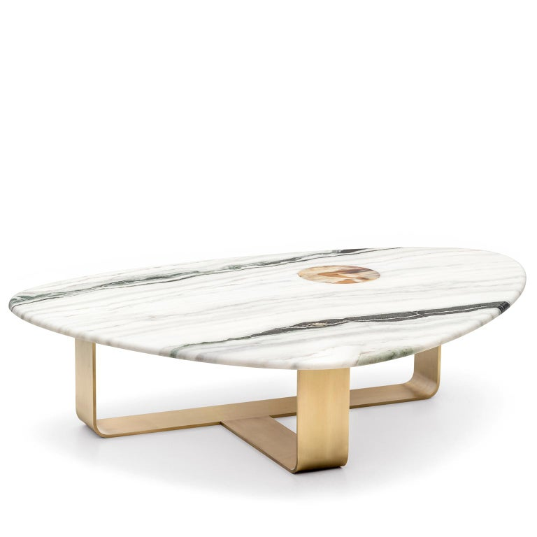 Artistic streak and craftsmanship excellence find their ultimate expression in Demetra coffee table, an eye-catching marriage of solemn materials and flawless shapes. Resting atop an elegant structure in satin metal, this table sports a