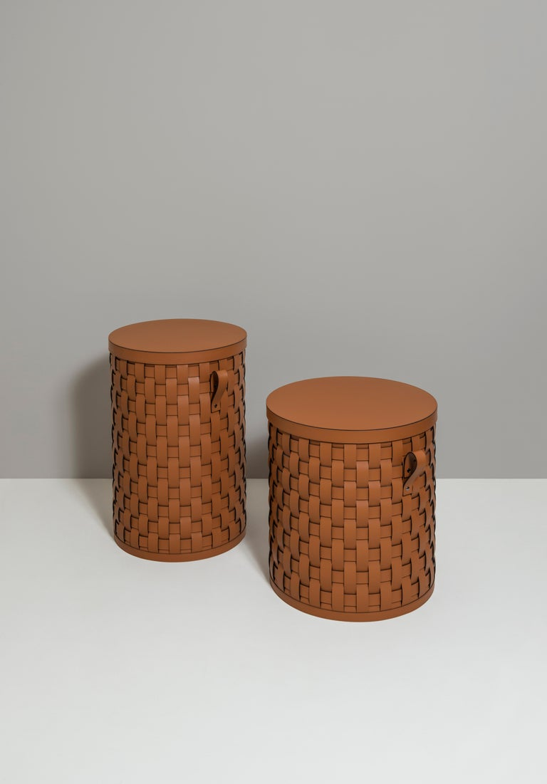 Pinetti's tall Demetra basket is handmade in Italy from eco-friendly and water-resistant brown leather making it useful for indoor or outdoor storage use.