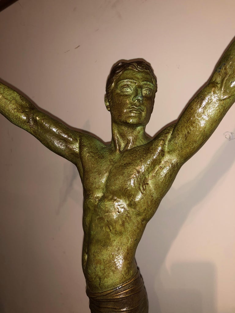 Demétre Chiparus 'Victory' Art Deco sculpture. Original pristine condition of petite bronze (white metal) in verdigris patina with gold accent details as well. Chiparus, the most famous Art Deco sculptor for many things, especially the male athletic