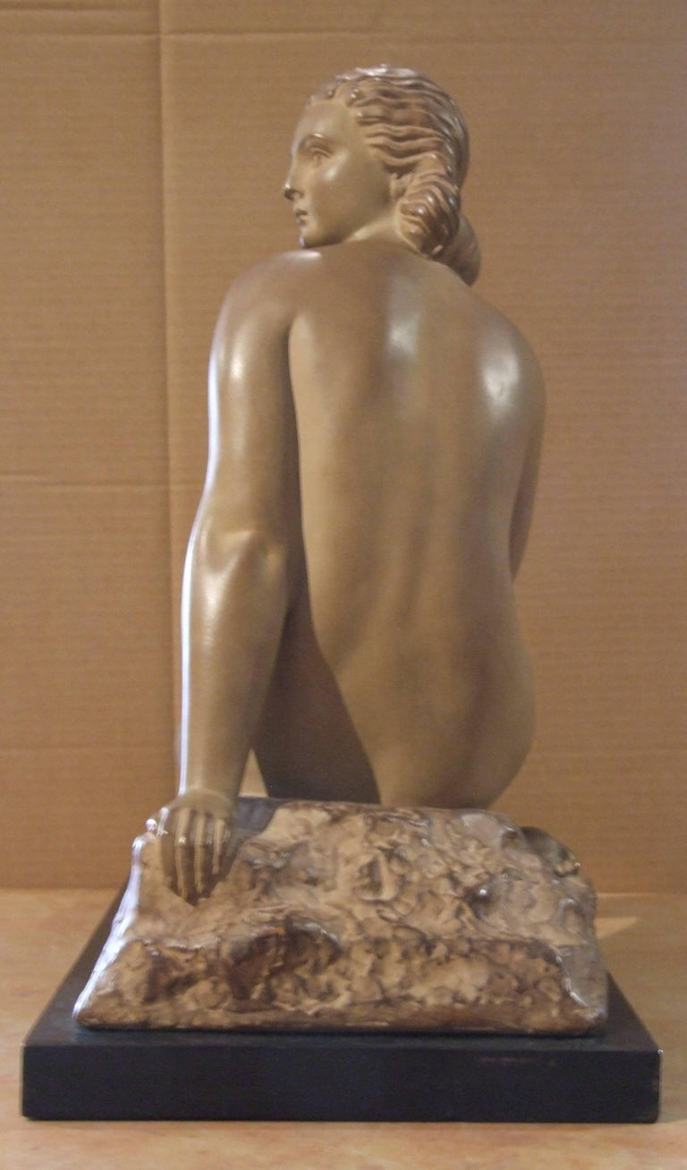 A rare sculpture made of clay by Demeter Chiparus, representing a sit nude woman. Signed on the sculpture. On a wood basement.  Demétre Haralamb Chiparus (16 September 1886 – 22 January 1947) was a Romanian Art Deco era sculptor who lived and worked
