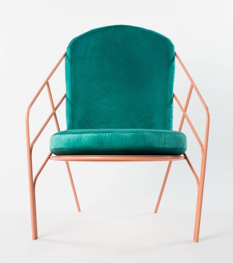 Powder coated stainless steel chair frame with removable cushions upholstered in an outdoor fabric, this chair looks great inside or out. The pink frame is fully welded and has a perforated seat pan that makes a statement even with the cushions off.