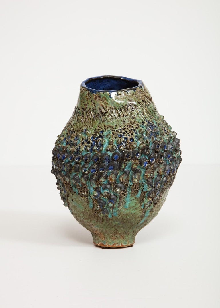 Hand-built irregular form, stoneware vase. Applied texture throughout with vibrant glazes. Artist-signed and dated on underside.