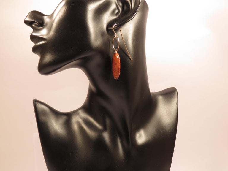 Beautiful earrings in rose 9k gold with natural dendritic agate. Total length of each earring is 60 millimeters / 2.36 inches. They are handcrafted in Italy by Botta Gioielli. This item is stamped with the Italian Gold Mark 375 - 716MI. Ready for
