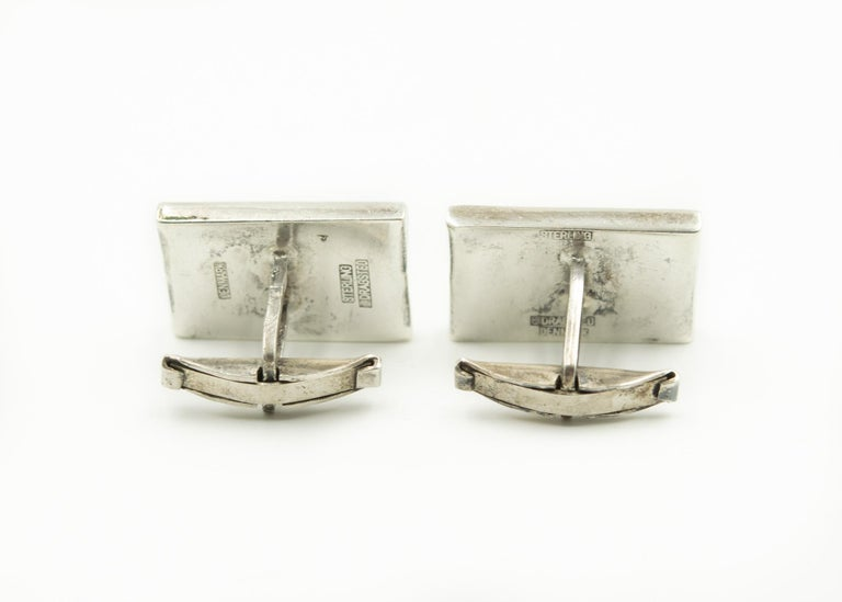 Mid 20th century modern cufflinks made by Danish silversmith E. Dragsted.  These elegant rectangular sterling silver cufflinks resemble a wave.  They have a whale tail back.  E. DRAGSTED Dragsted had a workshop in Copenhagen 1948-1958.