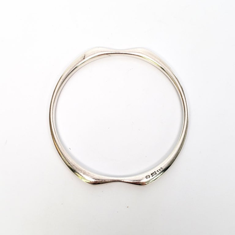 Vintage Georg Jensen Denmark, designed by Nanna Ditzel, sterling silver bangle bracelet, #155.  Modernist design by Nanna Ditzel from the later half of the 20th century.  Measures 2 1/2