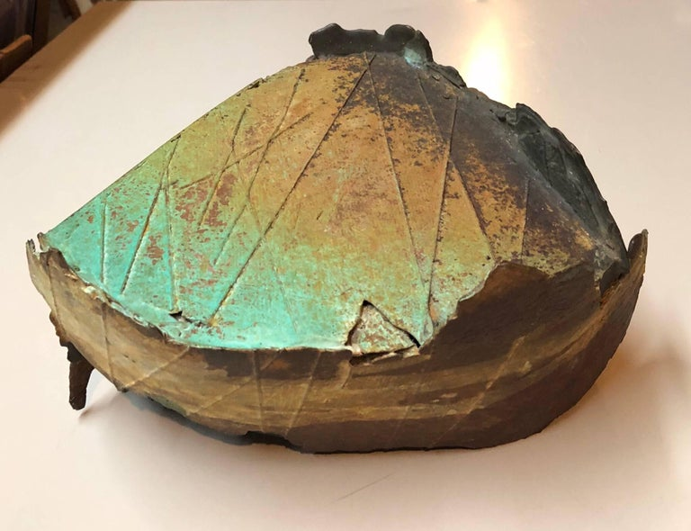 It has a variegated patina and texture to it. It does not appear to be signed. It was exhibited at Patricia Sweetow gallery in San Francisco.   Dennis Leon, was a San Francisco Bay Area sculptor and art instructor Mr. Leon was chairman of the