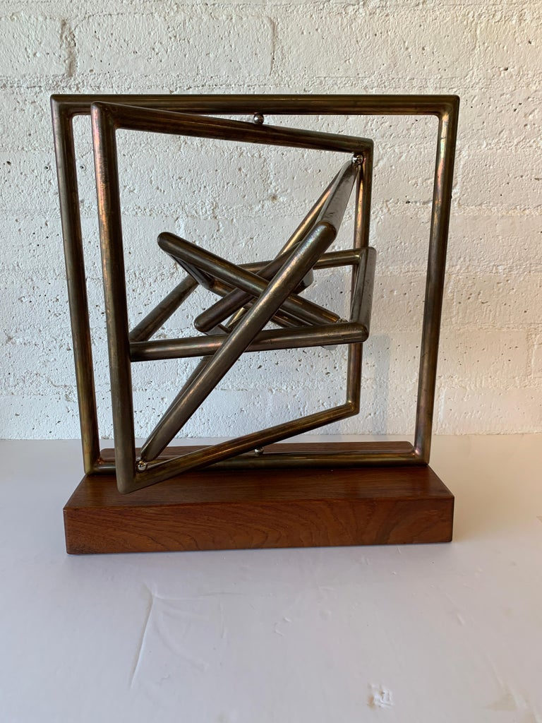 A wonderful large kinetic sculpture by the noted artist Dennis Stewart. Crafted out of copper and steel on a wood base. Lovely patina. Signed on on arm. Overall good age appropriate condition with wear and tarnish to copper and marks to base, mostly
